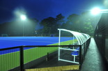 Floodlit pitch with dugouts